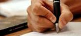 Imagem da mão segurando a caneta para escrever